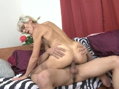 Horny granny with saggy boobs fucked by a toyboy