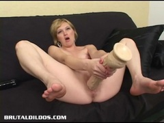 Horny blonde Jacinda fills her pussy with a big dildo