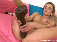 Sexy Laura Crystal gapes her pussy with huge dildo