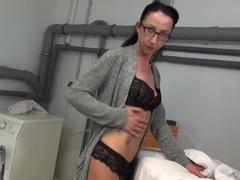 Sexy brunette mature masturbates in glasses