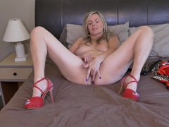 Mature blond fingers herself