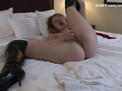 Spicy small pussy blonde masturbates in high boots