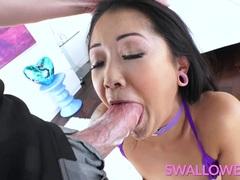 Hot Asian tattooed honey deepthroats it well