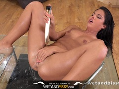 Stunning Spanish beauty covered in piss