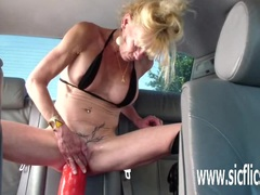 Anna fucks a gargantuan dildo in the back seat