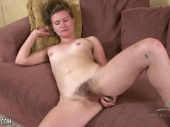Skyler plays with her bush before rubbing her hot pussy