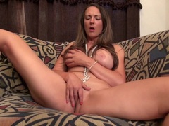 Busty brunette American babe playing with herself