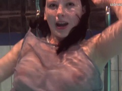 Katya Okuneva bouncing tits in a dress in the pool