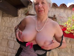 Horny granny playing outside