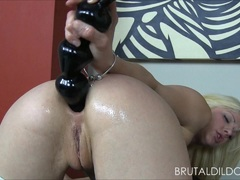 Petite blonde brutalizes both her holes with big rods