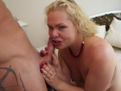 Blonde mature babe having fun with her toyboy lover