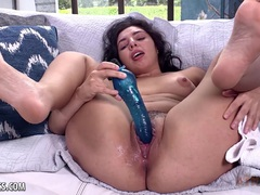 Brunette babe pleasures her pussy with blue fuck toy