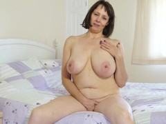 Busty European mature undressing and masturbation