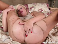 Horny blonde fingering wet pussy in ripped pantyhose