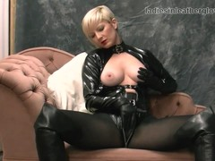 Blonde rubs leather gloves against wet pussy