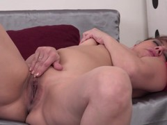 Hot MILF Gilda fingering and toying her pussy