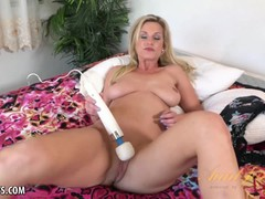 Naughty MILF Charlie Daniels using a strong toy