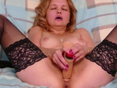 Naughty housewife Nelly playing with slot